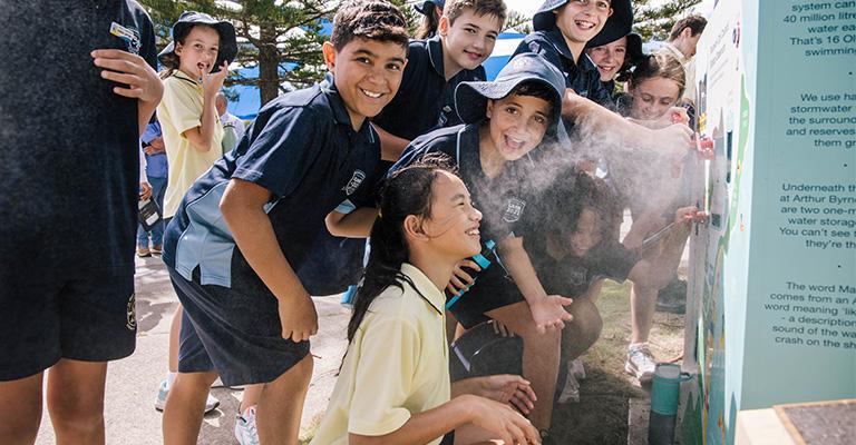 Kids get a little wet when using the new outdoor classroom!