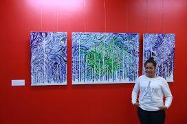 Artist-Nenase-Kavafolau-with-her-work-Opticalonix.jpg