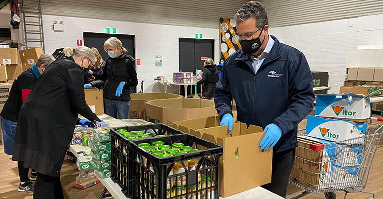 Mayor Danny Said joined volunteers packing food boxes at Addi Road in Marrickville.