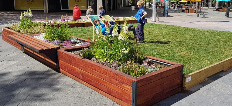 An example of a pop-up park with real grass.