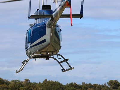 Helicopter lifting building supplies into Malabar Headland National Park