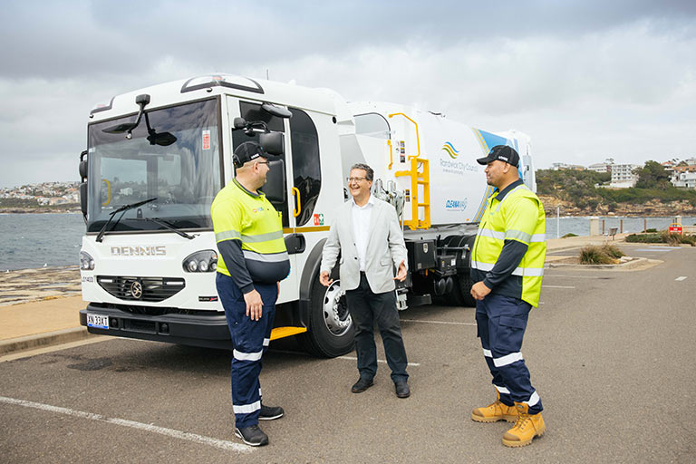 Mayor Danny Said with Cleanaway staff and the new fleet of garbage trucks.